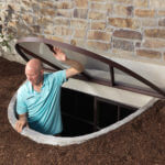 man opening polycarbonate window well cover