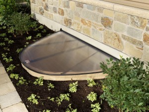 Rockwell Series egress window well with egress cover to improve curb appeal