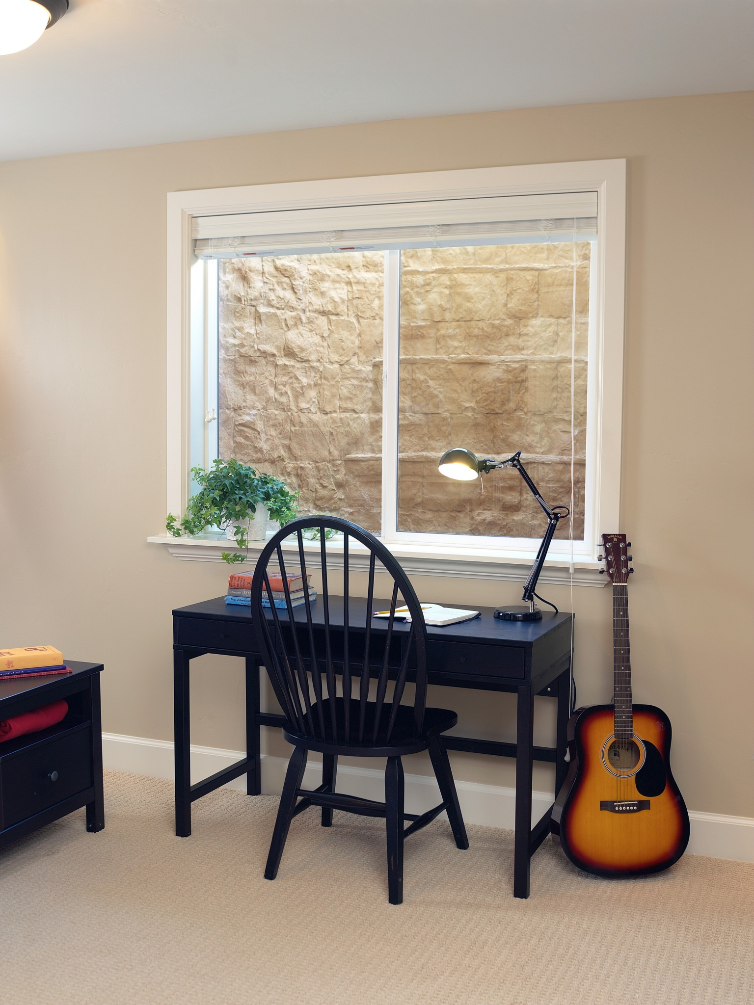 basement desk in front of Rockwell series egress window well built by RockWell egress window wells