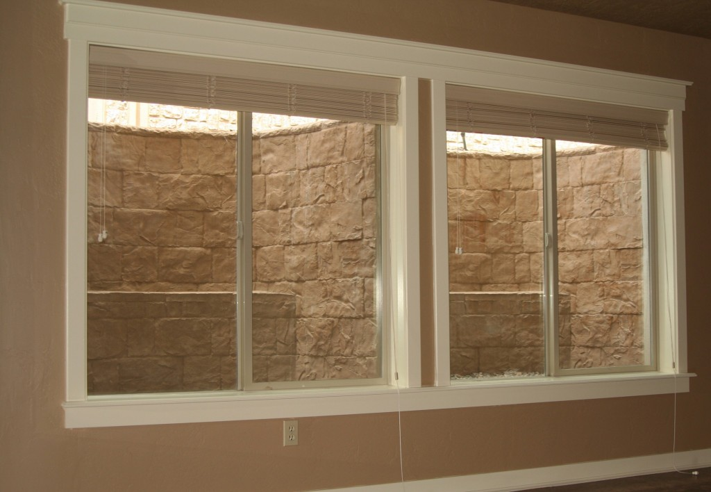egress window well covers in basement of a home