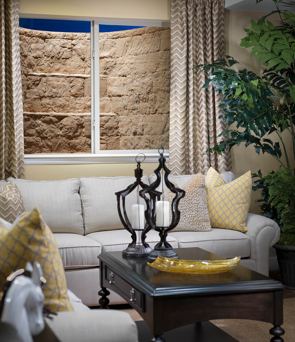 living room with faux stone window well cover