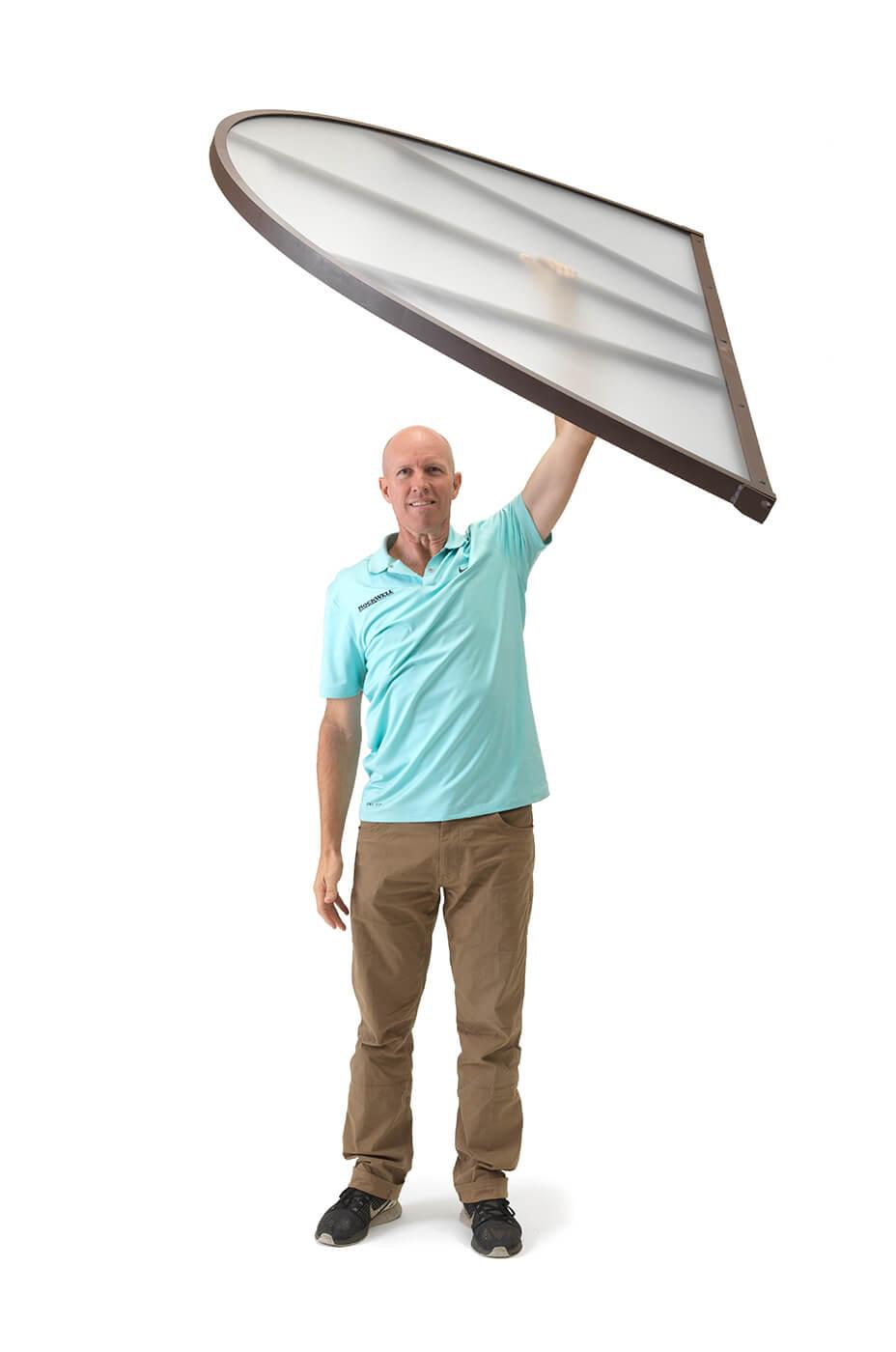 Man holding plastic window cover