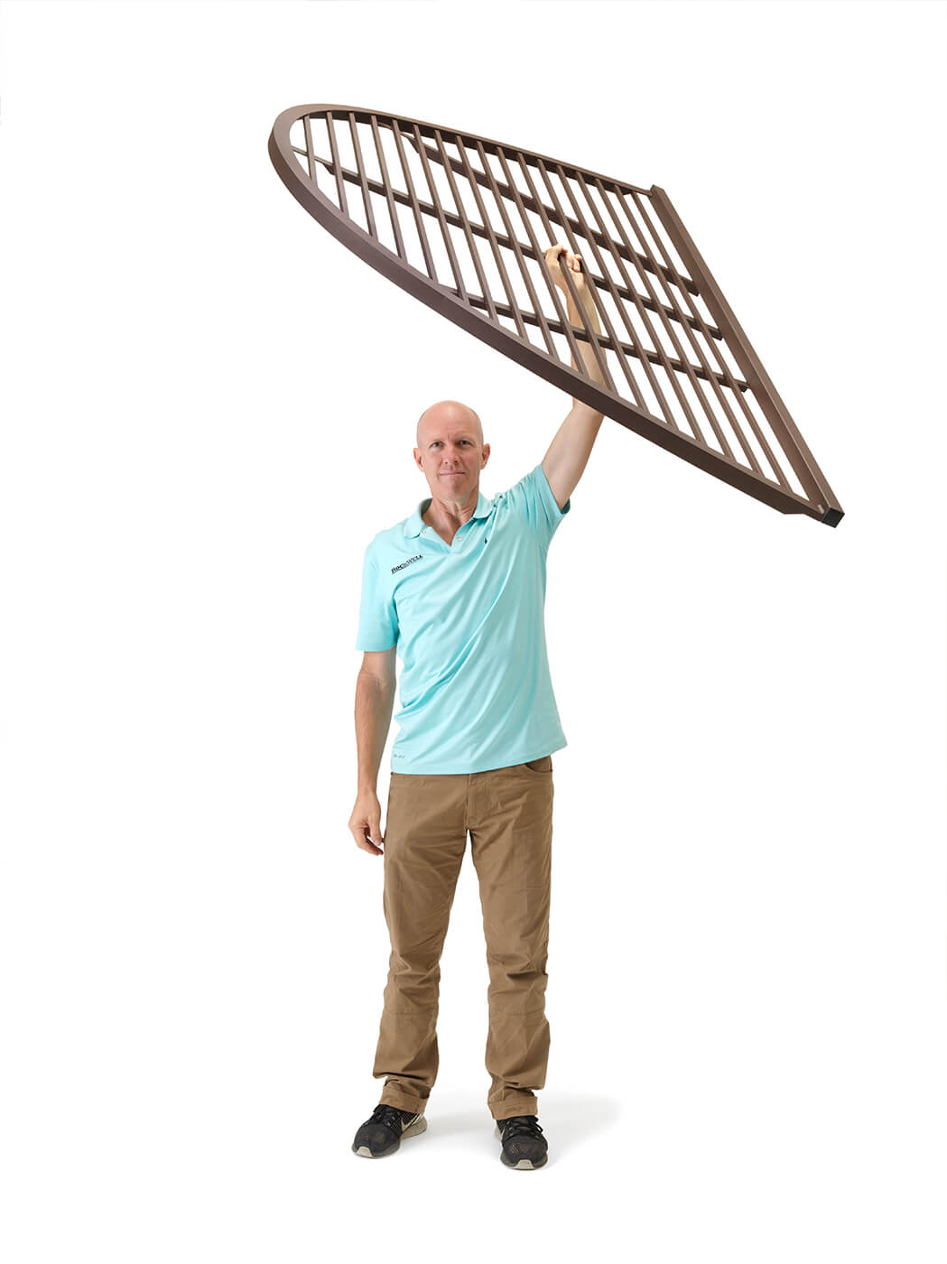 Man holding lightweight Rockwell series egress window well Cover and Egress window wells built by RockWell egress window wells and covers